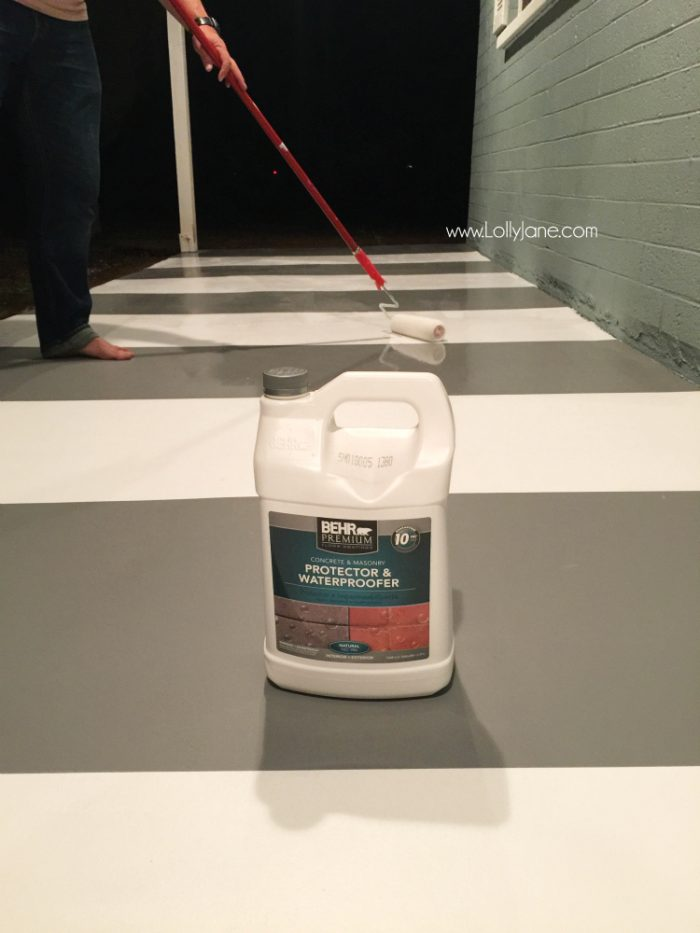 How to seal concrete floors: use a concrete waterproofer for secure adhesion. Click through for an awesome striped porch makeover.