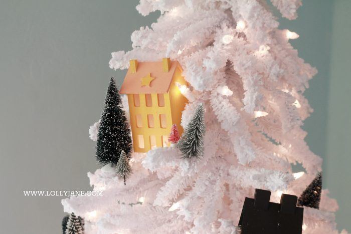 Darling Christmas tree! Love this winter village Christmas tree with Putz houses and bottle brush trees! Fun colorful Christmas tree idea!