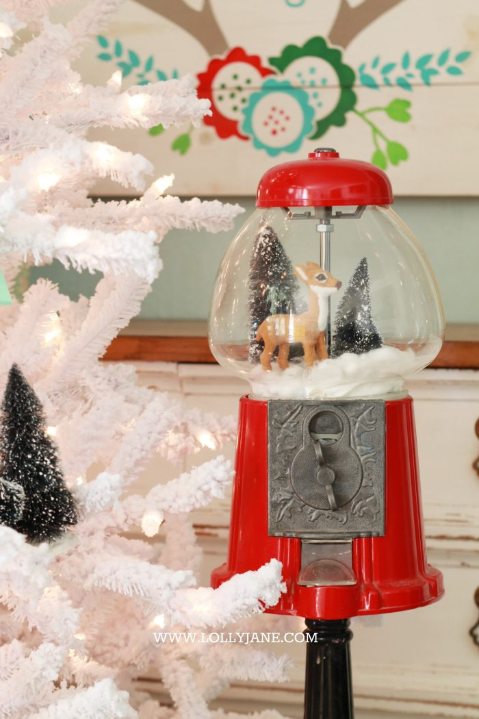Adorable bottle brush tree gumball machine snow globe! Just stretch cotton balls for snow, set a mini deer + bottle brush trees in a red gumball machine. Cute display via @lollyjaneblog | lollyjane.com