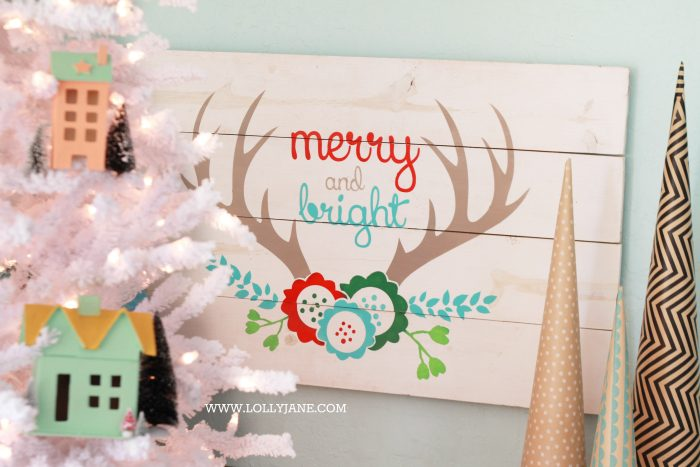 Festive merry and bright pallet sign! Head to LollyJane.com to see how to make this cute Christmas decor!