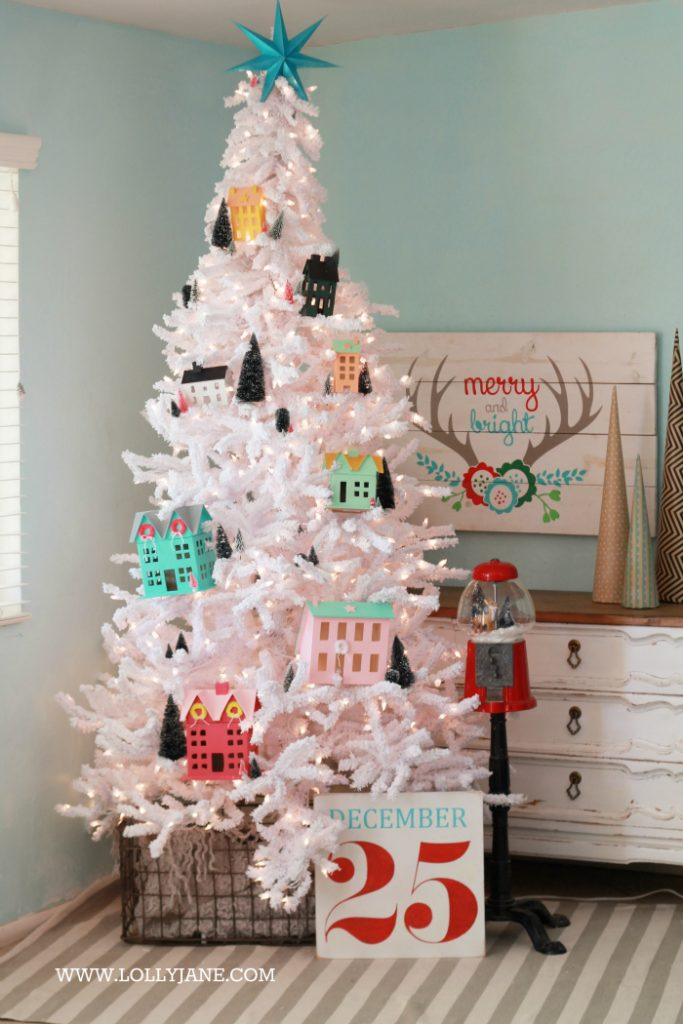 darling christmas tree love this winter village christmas tree with putz houses and bottle brush