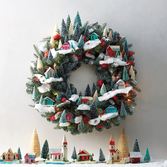 Love this easy DIY Village Christmas Wreath... and those bottle brush trees in it! LOVE! So easy to recreate this look, take a peek! #diy #bottlebrushtree #christmastree #christmasdecorations #christmasvillage