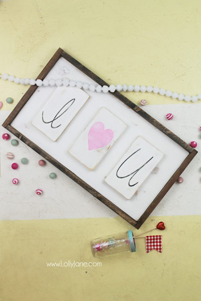 DIY Valentine's Day decor. Make these cute I heart U blocks then attach to a wood frame. Easy VDay decor, so cute!