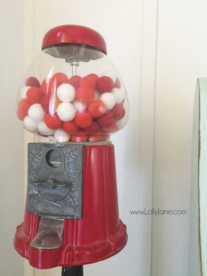 Fill a gumball machine with coordinating holidays for easy holiday decor! Cute Valentine's Day decor idea! Easy holiday decor!