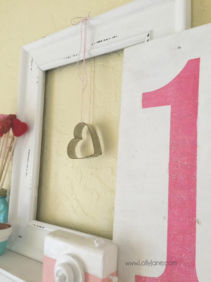 Easy Valentines Day mantel. Layer an empty frame, quick 14 sign for Valentine's Day mantel decor then fill in with random coordinating accessories. Love this easy Valentine's Day mantel!