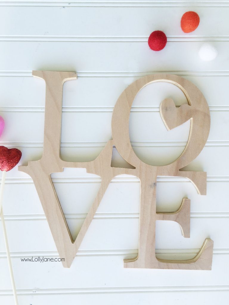 Cute unfinished LOVE wood cutout. For sale: https://www.etsy.com/listing/260307054/stacked-love-word-art-wood-cutout Cute and easy Valentines Day mantel decor!