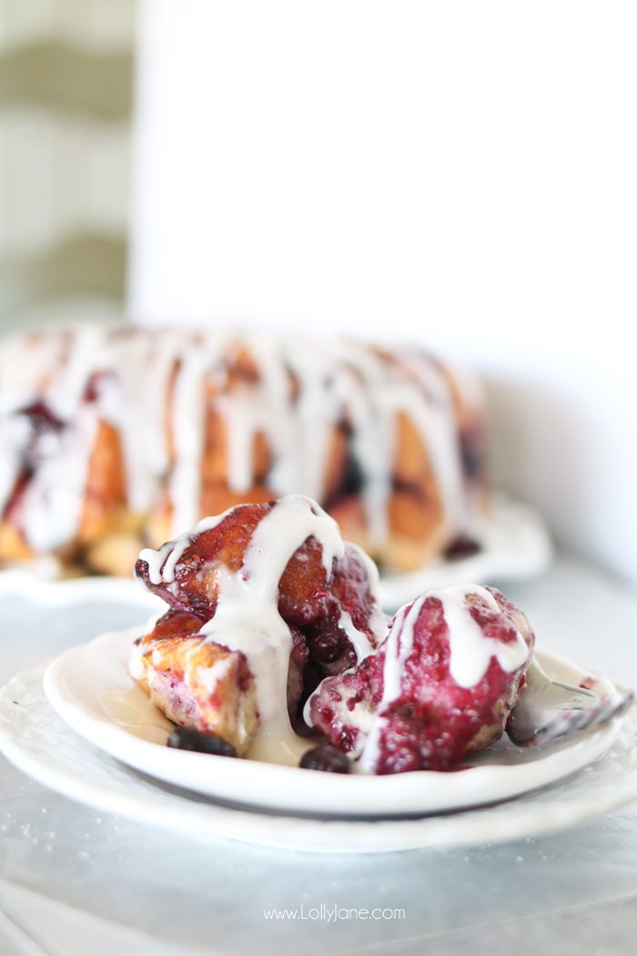 Easy Mixed Berry Monkey Bread filled cream cheese AND a cream cheese glaze. So dang good!