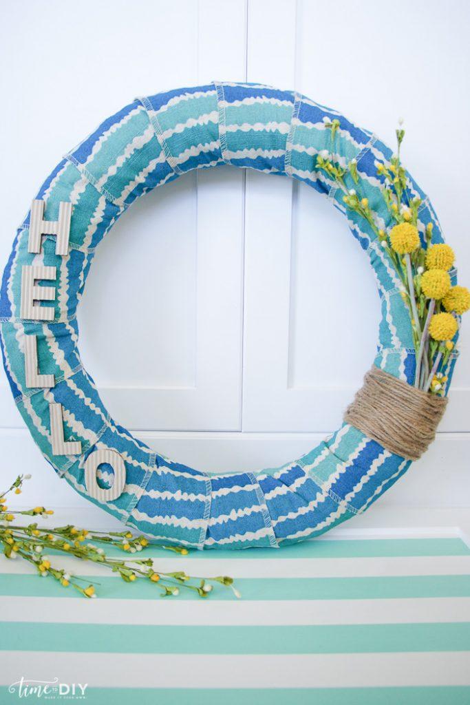 Easy summer wreath tutorial. Love this fabric wrapped wreath. Cute summer wreath tutorial!