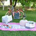 Here are some cute kids picnic ideas. Soft rug or blanket as a base with durable baskets filled with games, a cute chalkboard with a menu and game titles. Such a fun kids activity! Great kid entertainment and family activities ideas.