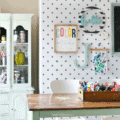 Easy to implement craft room makeover ideas using peel and stick wallpaper. Check out this cute craft room with polka dot peel stick wallpaper, so fun! #craftroom #makeover #roommakeover #peelstickwallpaper #peelandstickwallpaper