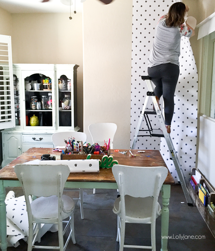 How to apply peel and stick wallpaper for this cute craft room makeover! Love this craft room update using easy to apply wallpaper in a fun polka dot pattern. #peelstick #wallpaper #peelstickwallpaper #polkadotwallpaper #craftroom #craftroommakeover