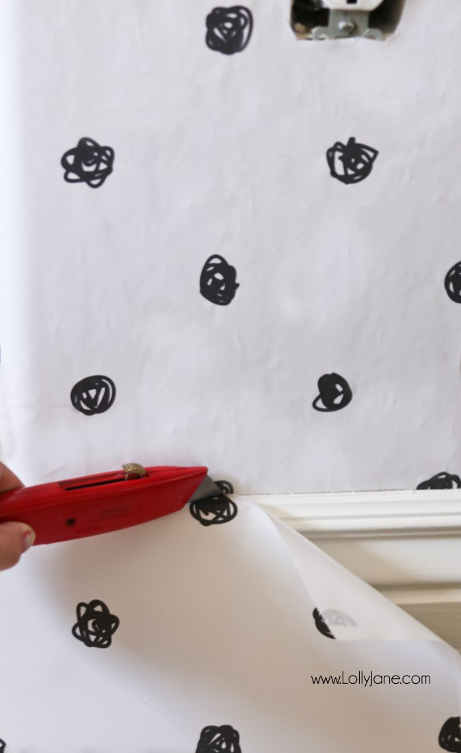 Wondering how to cut wallpaper panels when using peel and stick wallpaper? Use an XActo Knife to cut the end of the wallpaper panel at the baseboard, so easy to get a perfect cut when cutting downward. #wallpapertip #peelstickwallpaper #howtoapplywallpaper #polkadotwallaccent #blackwhitewallpaper