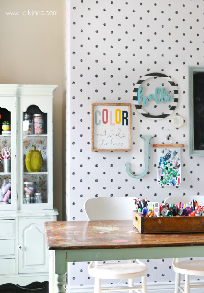 Loving this peel and stick wallpaper craft room makeover, so fun and playful! Love this black and white polka dot wallpaper pattern, learn to apply it easily! #wallpaper #polkadotpattern #peelstickwallpaper #craftroom #craftroommakeover #colorfulcraftroom