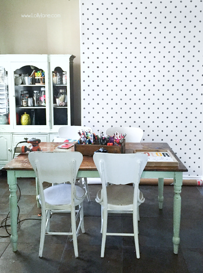 Check out how this peel and stick wallpaper transformed my craft room makeover. Love this easy to apply wallpaper in a fun polka dot pattern. #blackwhitewallpaper #howtoapplywallpaper #scribbledotpattern #wallpaperapplication #stickonwallpaper #wallpaperpeelstick