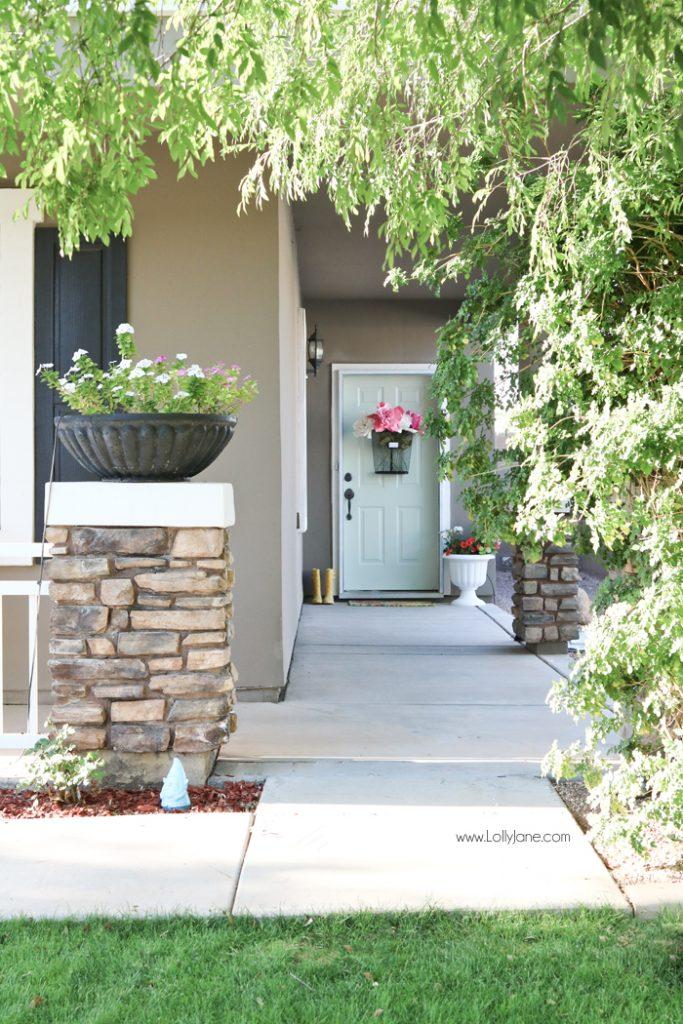 Easy Springy Porch Refresh... love this Door Makeover! Fast outdoor makeover idea, really cute home decor ideas! #diy #stencil #Dutchdoor #pinkdoor #makeover #porchdecor #porchmakeover
