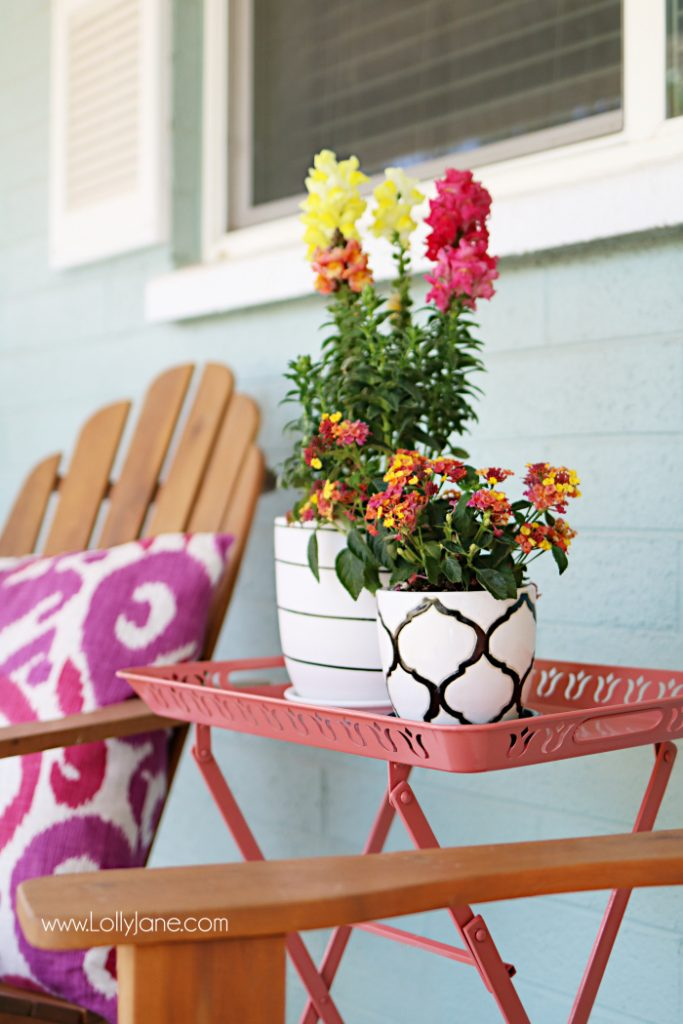 Summer porch decor ideas! Love the pops of coral and bright summer colors! New vases with colorful flowers really brighten up this summer porch! Great summer porch decor ideas!