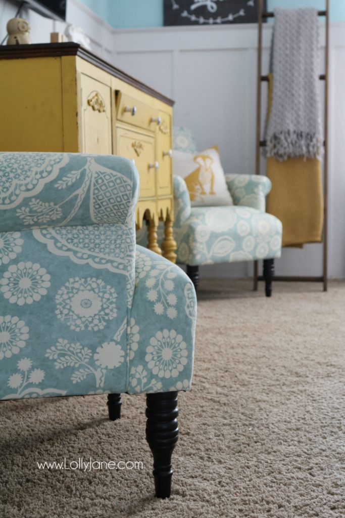 Pretty colorful farmhouse family room decor. Easy ways to pull together a family room space. Pretty farmhouse decor ideas. Love this colorful family room! These billy balls in vintage blue mason jars are such cute decor too. Pretty blue wingback accent chairs complete the space!