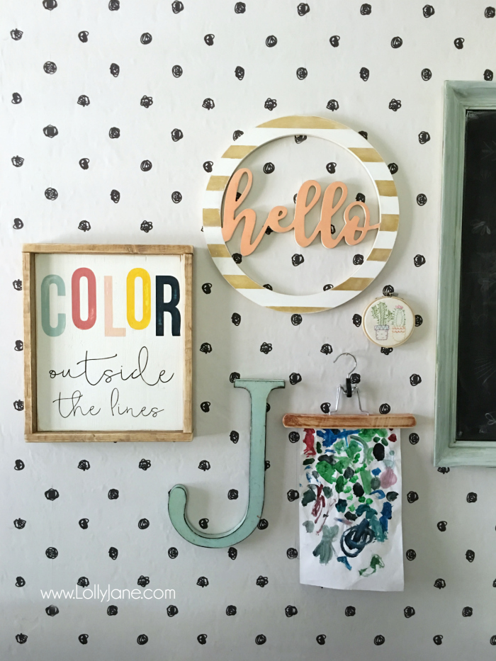 Pretty craft room gallery wall! Love the striped wood wreath!