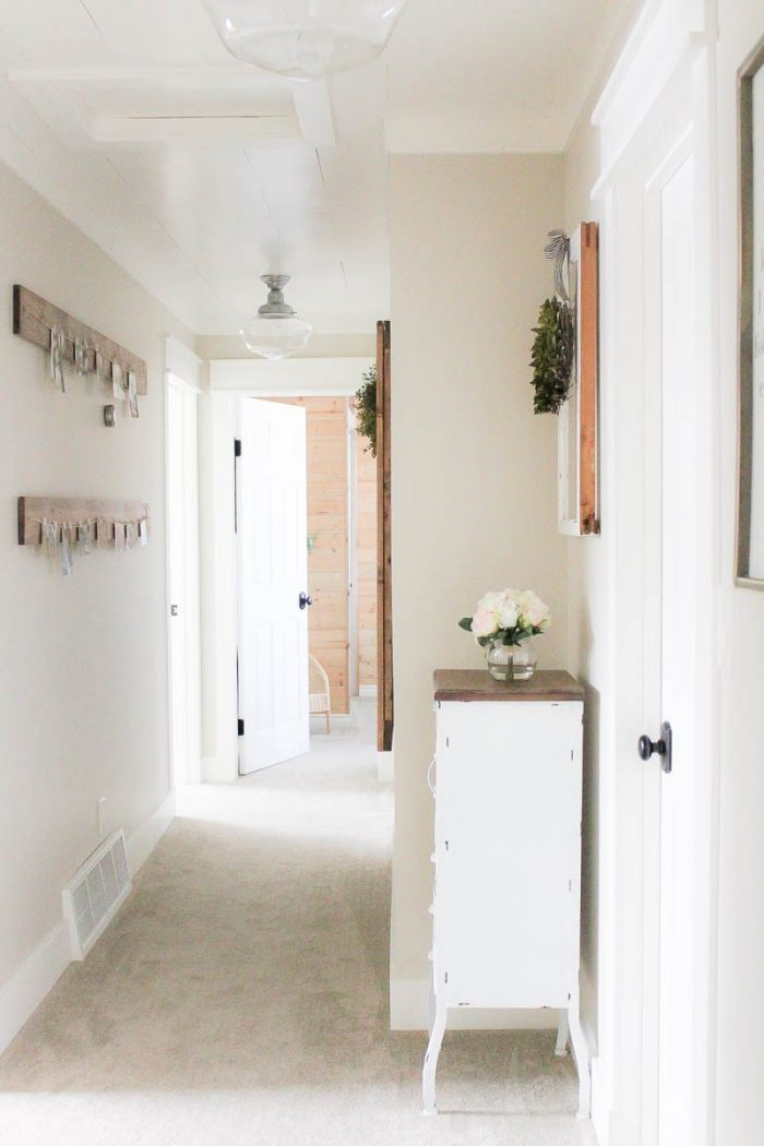 Pretty Farmhouse Style Hallway! via MakingItInTheMountains.com
