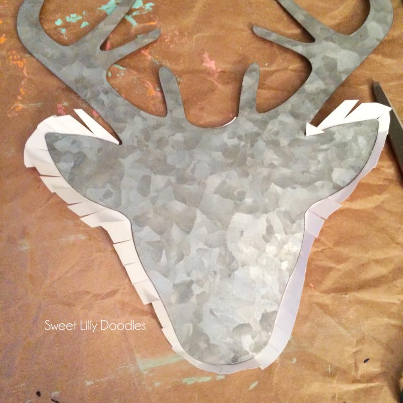 DIY floral deer head pallet art. Easy DIY deer head silhouette craft! Love this Rifle Paper Co floral covered metal deer head art!