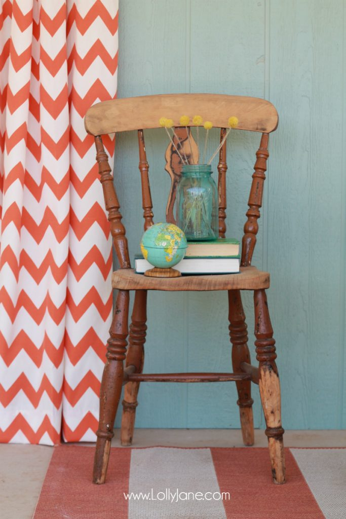 Love this vintage chair and globe bank thrift decor.