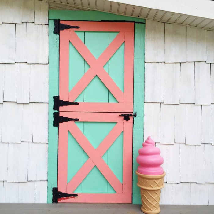 Darling old she shed turned playroom! Love the painted argyle + polka dot patterns! Too cute!