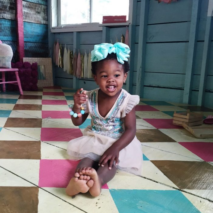 Darling old she shed turned playroom! Love the painted argyle, stripes + polka dot patterns! Too cute!