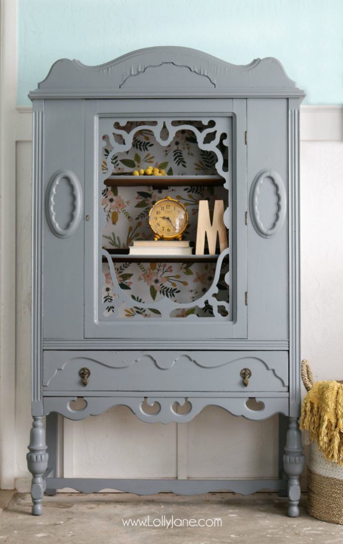 Gorgeous gray hutch with floral paper makeover. Such a dramatic before after furniture makeover. Love this gray hutch with pretty floral paper!