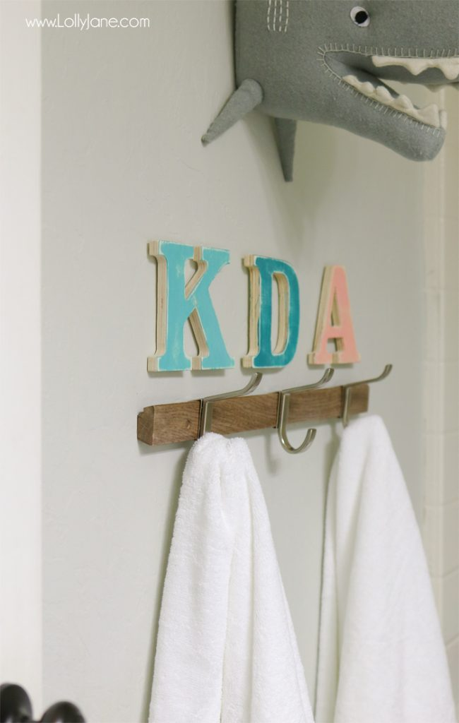 Cute kids bathroom! Refreshed for less than $100 and super organized... love the printable art, too!