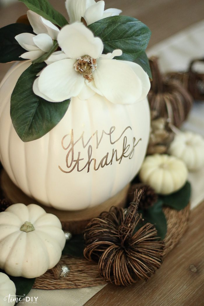 DIY Faux Magnolia Pumpkin | Such a cute fall pumpkin home decor craft! Love this hello fall pumpkin decor! Cute fall decor!