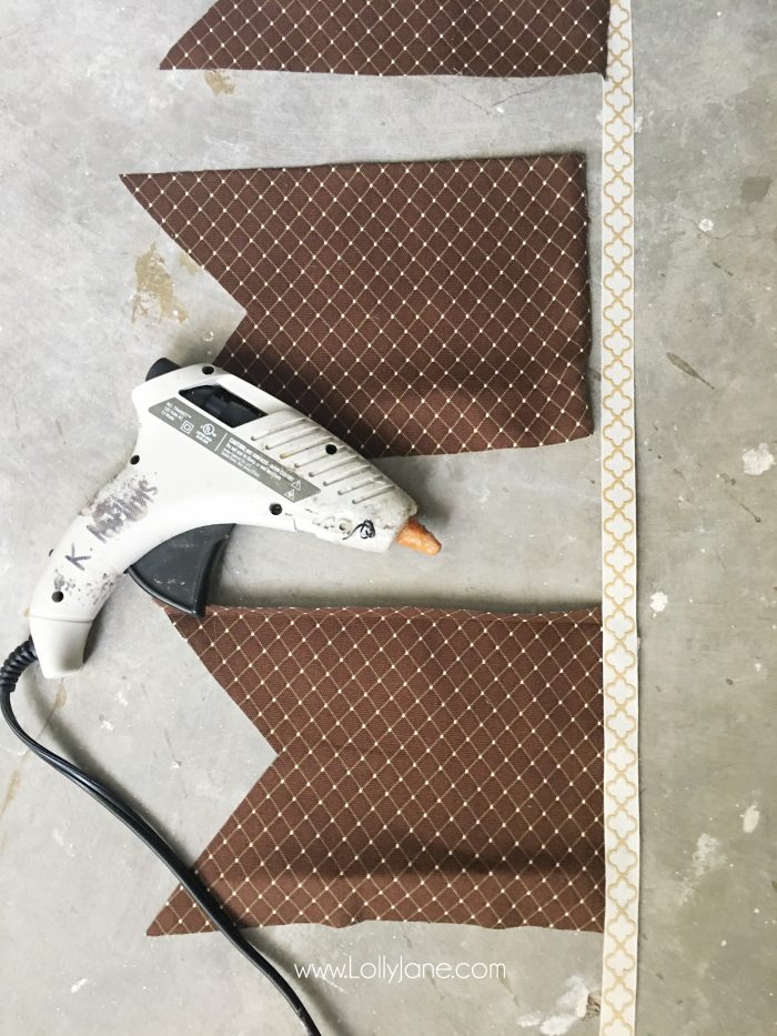 """Cut the second fold so it creates a """"triangle bite"""" out of the bottom."""