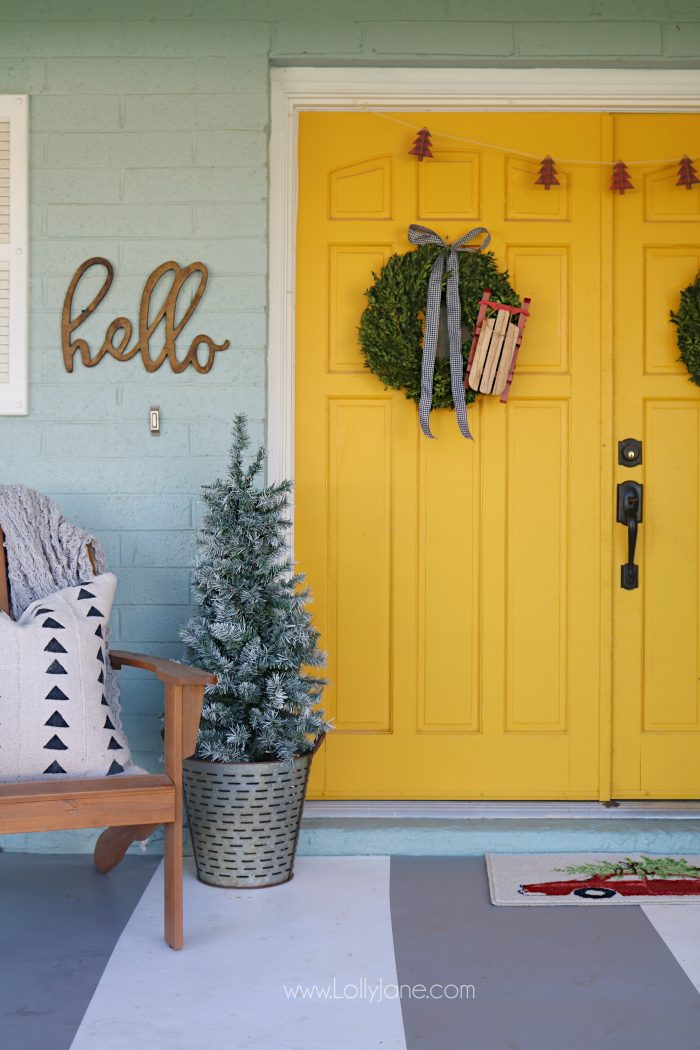 Farmhouse Christmas porch decor. Easy ways to bring a little farmhouse charm to the outdoors. I love those fresh boxwood wreaths!