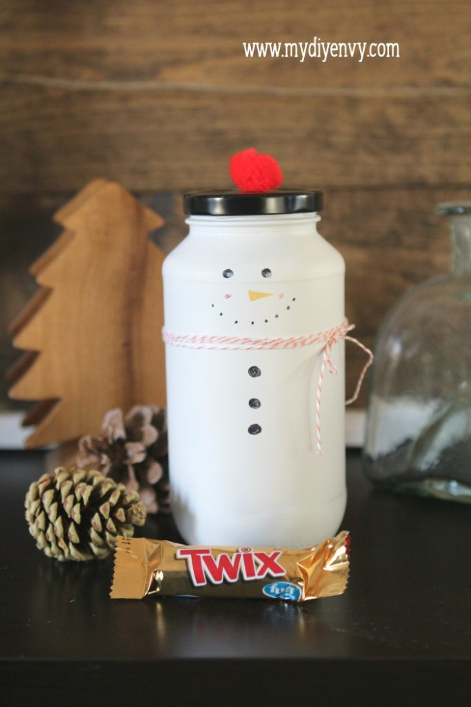 DIY Snowman Candy Jar   Such a cute Christmas craft! Recycle old glass jars into snowman candy jars, cute Christmas gift idea, just fill with candy. Love handmade Christmas gifts!