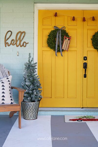 Farmhouse Christmas porch decor. Easy ways to bring a little farmhouse charm to the outdoors. Love the olive buckets and fresh boxwood wreaths.