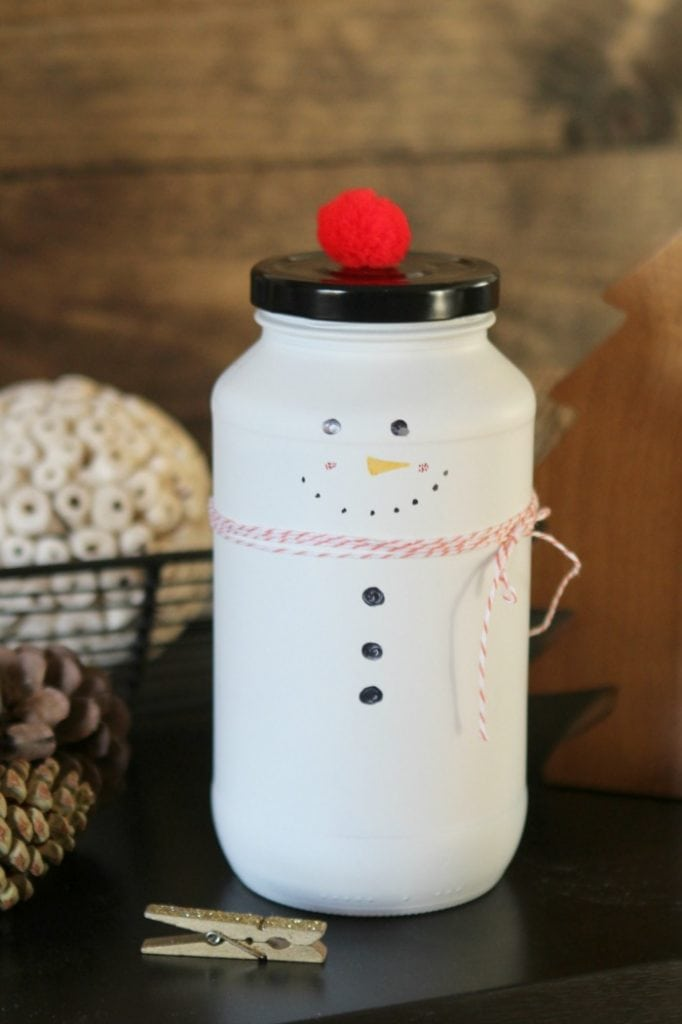 DIY Snowman Candy Jar | Such a cute Christmas craft! Recycle old glass jars into snowman candy jars, cute Christmas gift idea, just fill with candy. Love handmade Christmas gifts!