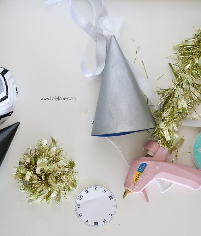 Paint or wrap fabric around dollar store party hats for EASY and cheap glam New Years Eve party gear! Cute!Paint or wrap fabric around dollar store party hats for EASY and cheap glam New Years Eve party gear! Cute!