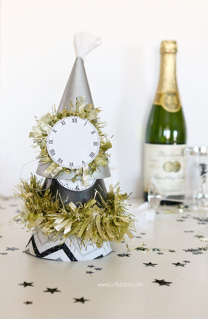 Paint or wrap fabric around dollar store party hats for EASY and cheap glam New Years Eve party gear! Cute!