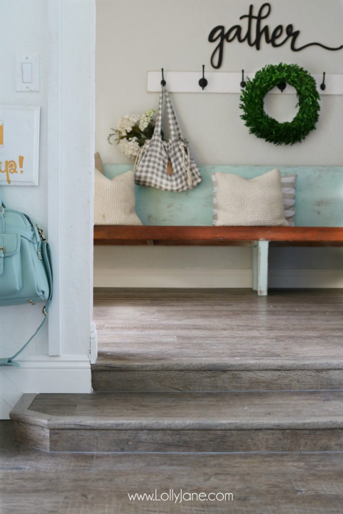 Love these vinyl floors from @GoHaus. They look great in my farmhouse style home! Adore this farmhouse entrway and gather wood cutout too!