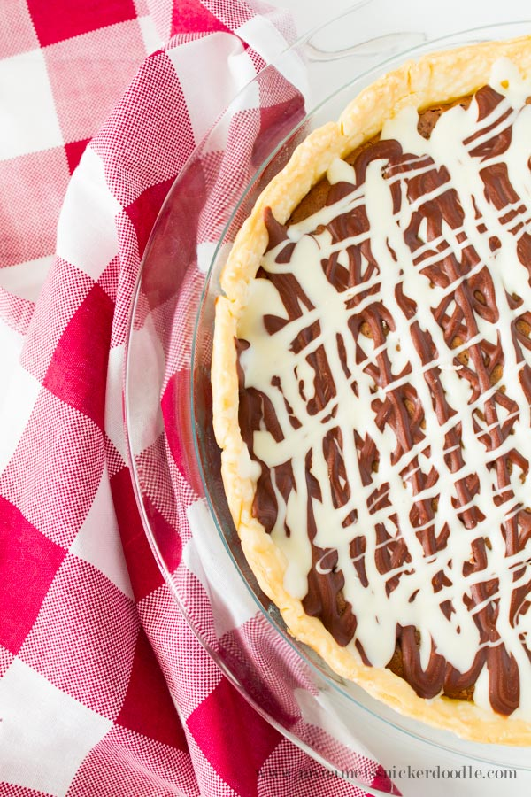 Fudge Brownie Pie recipe. This pie is some of the best comfort food that can be found! A must try chocolately fudge brownie pie!