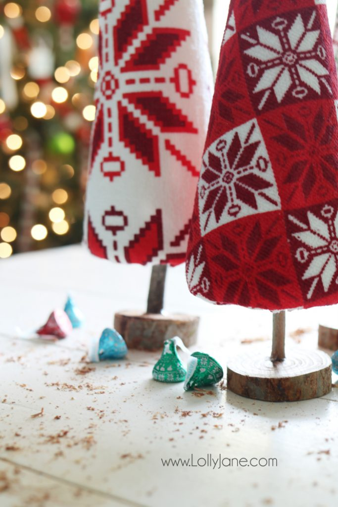 """Fun DIY ugly sweater trees craft! These """"ugly sweater"""" trees are cute Christmas decor and make a great centerpiece! Easy Christmas craft idea! Upcycle inexpensive hand towels into Ugly Sweater Christmas trees!"""