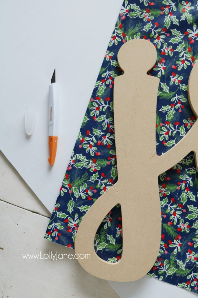 DIY wood cutout sign tutorial. Learn how to cover a wood cutout with paper the proper way then mount to a sign! Such an easy to follow sign tutorial. Love this diy sign. Cute joy sign!