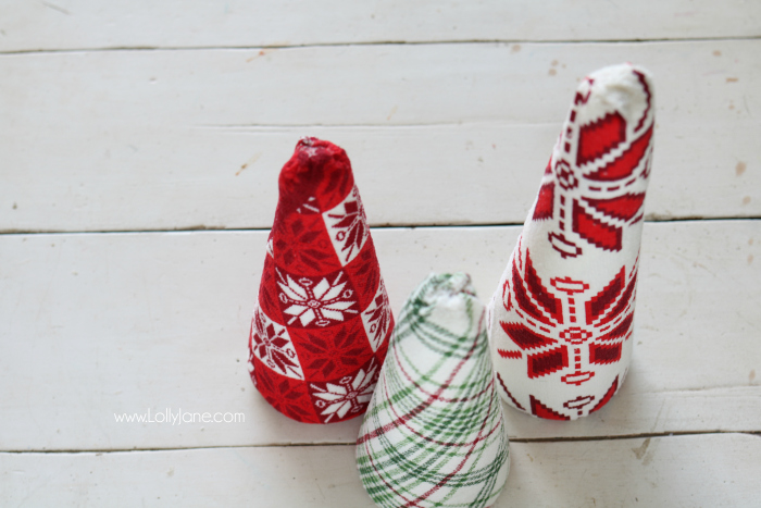 "Fun DIY ugly sweater trees craft! These ""ugly sweater"" trees are cute Christmas decor and make a great centerpiece! Easy Christmas craft idea! Upcycle inexpensive hand towels into Ugly Sweater Christmas trees!"