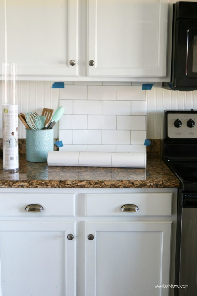 Faux Subway Tile Backsplash... this is WALLPAPER! Looks like real tile, get the easy how-to which is perfect for renters or those on a budget!