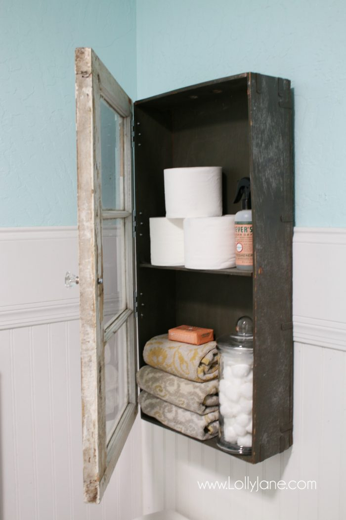 This rustic bathroom cabinet is killing me, so cute and unreal how easy it was to make!