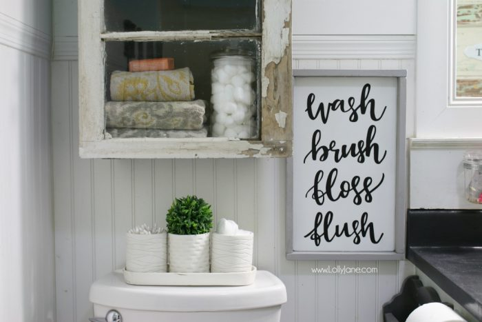 Such a pretty farmhouse bathroom! All DIY like this handmade cabinet. Please get me that sign!