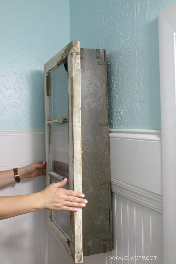 An old trunk and vintage window really function as a bathroom cabinet!?