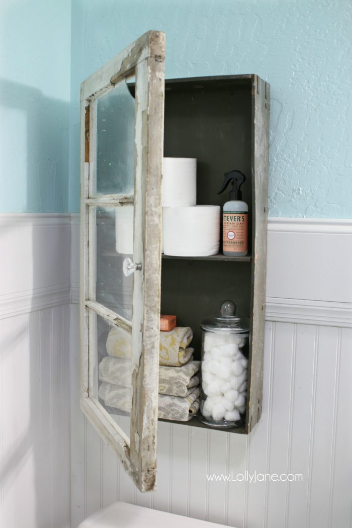 Forget standard bathroom cabinets, this was less than $100 and is the easiest rustic bathroom diy you've ever seen!