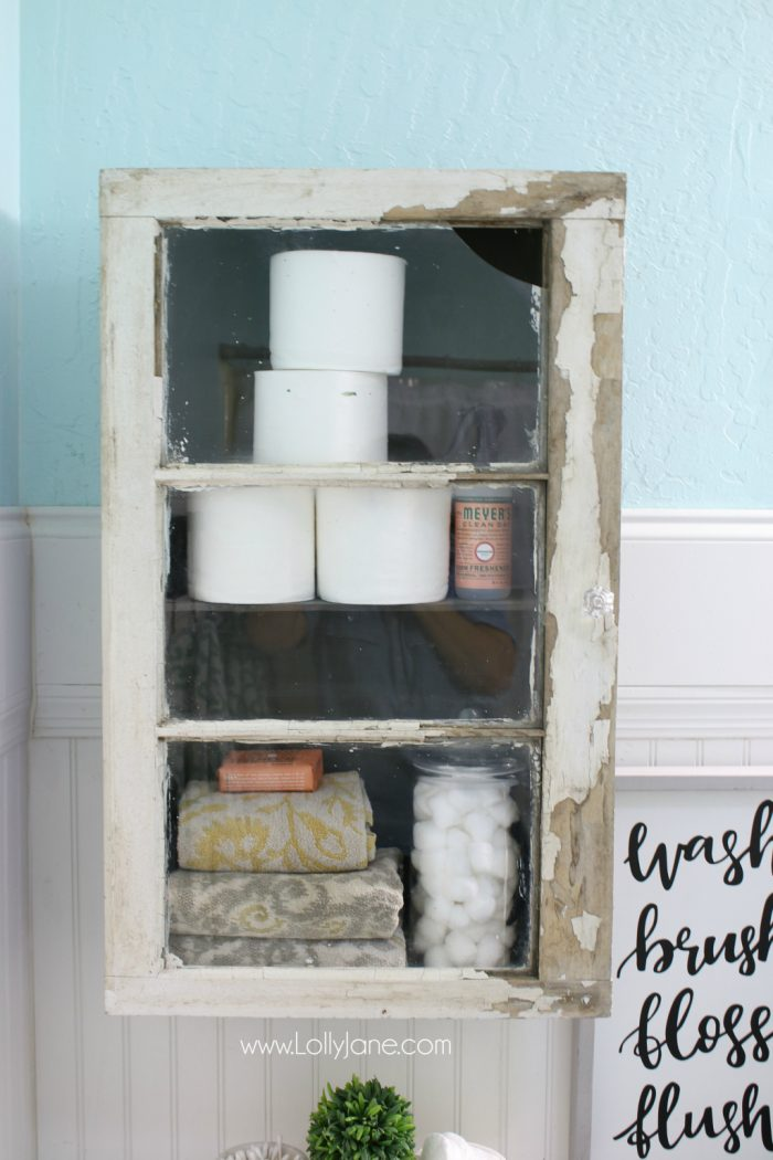 Learn how to turn a trunk and window into a bathroom cabinet. Great storage solution!