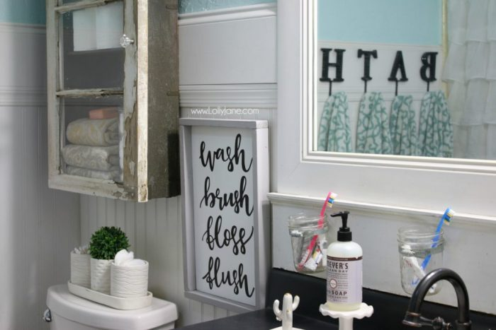 Darling bathroom cabinet diy. Love this rustic farmhouse bathroom. Great cabinet makeover!