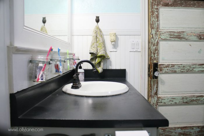 I chalk painted my bathroom countertops! I actually love my chalk paint laminate countertops, they are a fast solution to replace bathroom counters! Check out this easy chalk paint countertops tutorial! Great home renovation idea, super affordable bathroom remodeling idea.